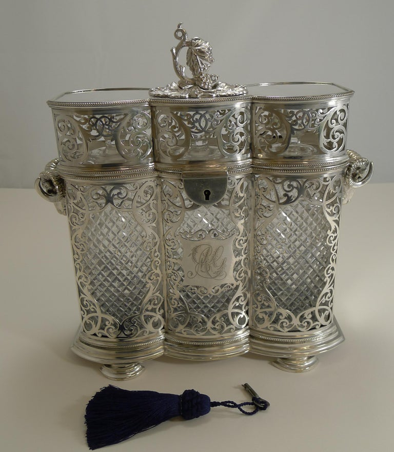 A truly magnificent three bottle decanter case made from silver plate and fully marked for the Sheffield silversmith's, Philip Ashberry & Sons, dating to circa 1870.