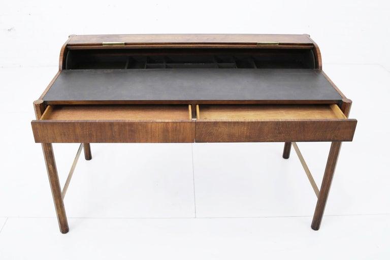Well made writing desk by Hekman. Walnut with brass hexagonal shape legs with brass stretchers and hardware.
