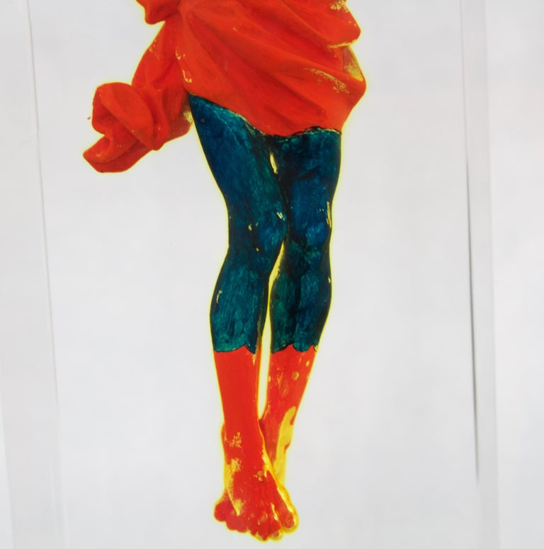 This is an original one-of-a-kind sculpture. Helder uses a Christ figure painted to mimic Superman's red and blue outfit with 'S' logo. The figure is suspended in a crucifix resin form.  About the Artist Helder Batista is a self-taught artist who