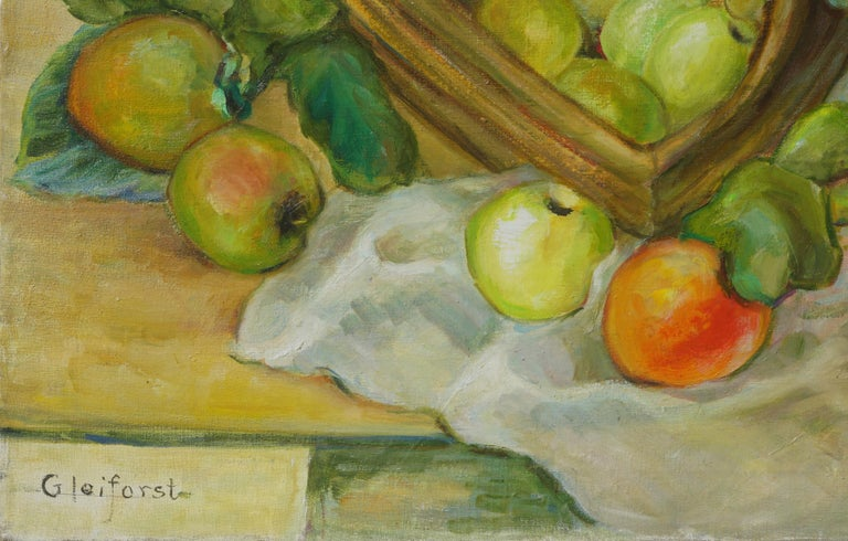 """Gorgeous mid century still life in the style of Paul Cezanne of a fruit basket with a turquoise blue pitcher by Carmel and Hollywood artist Helen Gleiforst (American, 1903-1997), circa 1950. Signed lower left """"Gleiforst."""" Presented in gilt-toned"""