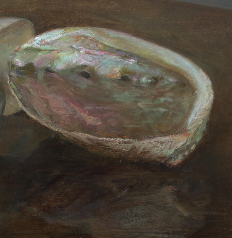 The two shells - a nautilus and an abalone - are beautiful in their simplicity in this still life by Helen Oh.  The rich hues of the shell's mother of pearl surfaces are reflected onto the deep dense color of the table on which they are placed.  The