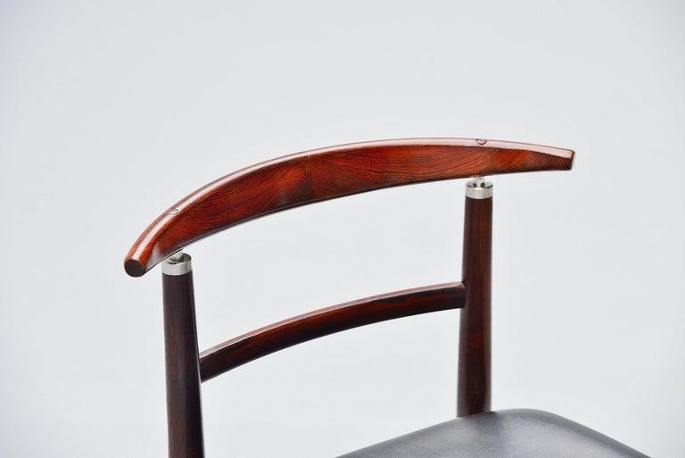 Nice sculptural chair model 465 designed by designer duo Helge Sibast and Borge Rammeskov and manufactured by Sibast Mobler, Denmark, 1962. This chair has a solid rosewood frame and black leatherette upholstery. The chair is great to use as a desk