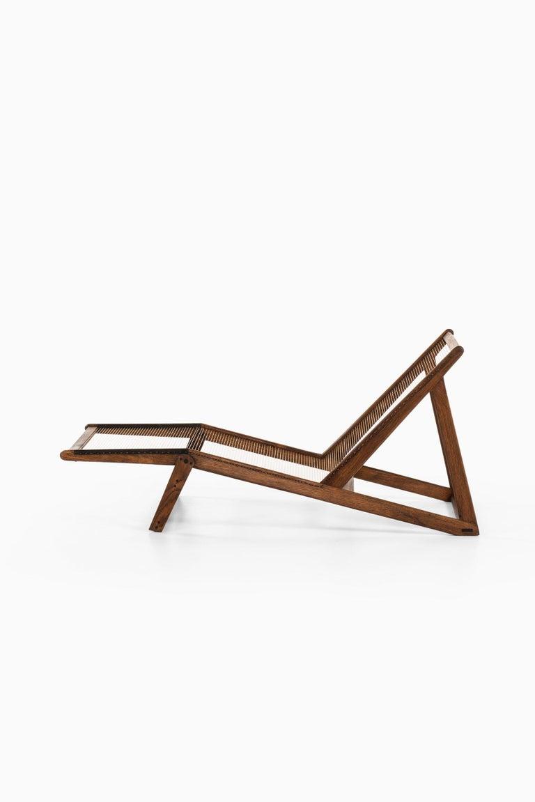 Very rare lounge chair designed by Helge Vestergaard-Jensen. Produced by cabinetmaker Peder Pedersen in Denmark.