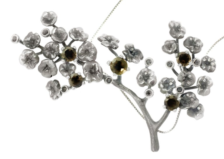 This beautiful Heliotrope necklace by artist has 34 white and black diamonds and 5 smoky quartzes. It was made of dark silver, which gives the piece the look of designer jewellery, new gothic and unique. The diamonds and quartzes are blinking,