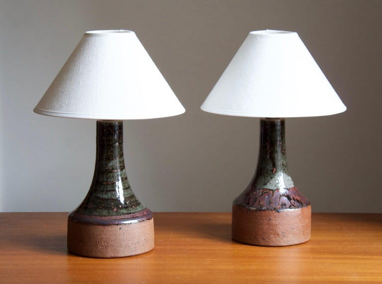A pair of table lamps designed and produced by Helle Allpass in her studio, Denmark, 1960s. Features a highly artistic glaze. Stamped  Stated dimensions exclude lampshades. Height includes socket. Sold without lampshades.