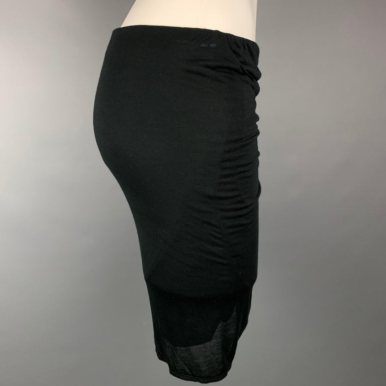 HELMUT LANG mini skirt comes in a black jersey modal featuring a ruched design anda elastic waistband.  New With Tags.  Marked: S Original Retail Price: $195.00  Measurements:  Waist: 29 in. Hip: 34 in. Length: 21 in.