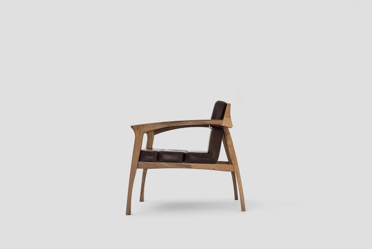 Helmut is a lounge chair fabricated in walnut wood and leather seats designed by Arturo Verástegui for Breuer Estudio. This piece is part of Diseño y Ebanistería, Breuer Estudio first ever collection, in which they collaborated with top designers to