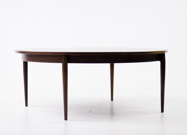 Elegant and refined large round coffee table in rosewood made by Heltborg Møbler.