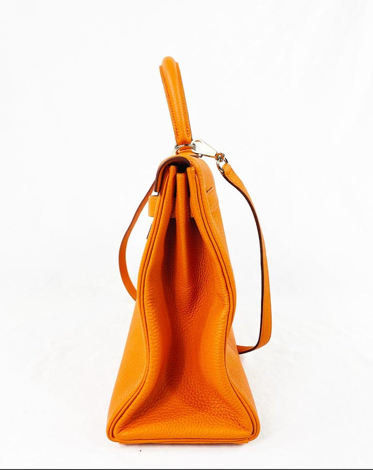 Hermes Retourne 35 Kelly Soft Orange Leather Handbag  Product details: BRAND NEW Includes: shoulder strap, lock, keys, rain protection, dust bag, box and a Hermes shopping bag Hermes orang leather Platinum tone hardware Single rolled top