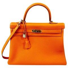 Hemes Soft Retourne 35 Kelly Orange Leather Handbag