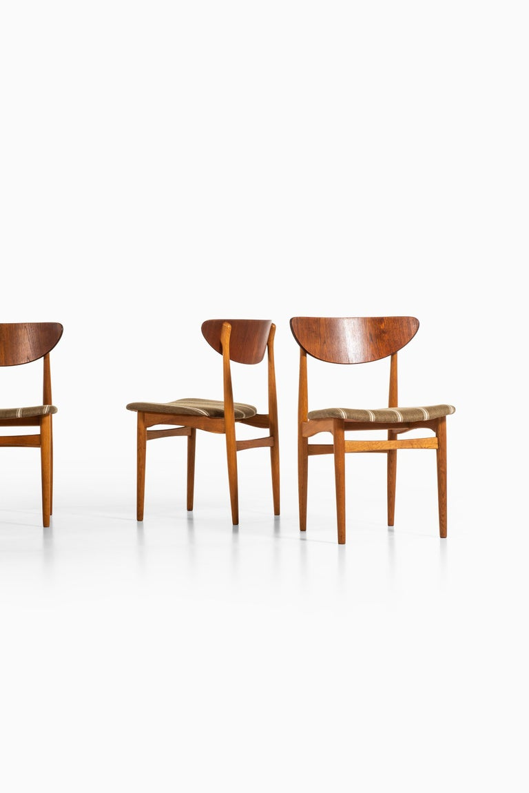 Rare set of 12 dining chairs designed by Henning Kjærnulf. Produced by Sorø Stolefabrik in Denmark.
