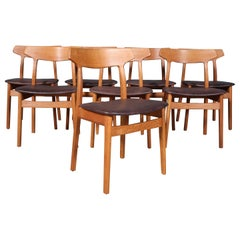 Henning Kjærnulf Eight Oak Dining Chairs