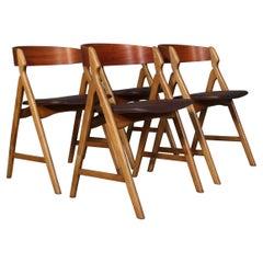 Henning Kjærnulf Four Teak Dining Chairs