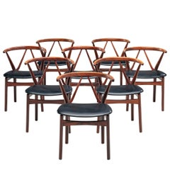 Henning Kjaernulf Set of Eight Dining Chairs in Rosewood