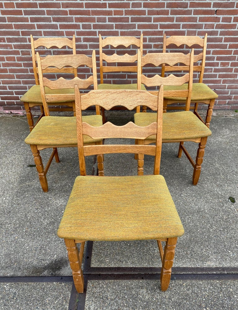 Midcentury set of six dining chairs, Model Razorblade'. The chairs consist of a solid oak base and remain in original condition. Wear consistent with age and use. Easy to reupholster. Price per piece.