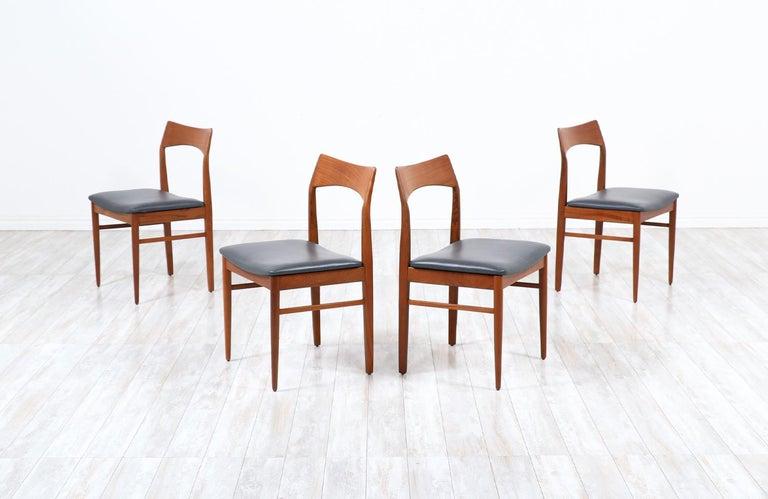 Henning Kjærnulf teak & leather dining chairs for Vejle Møbler.