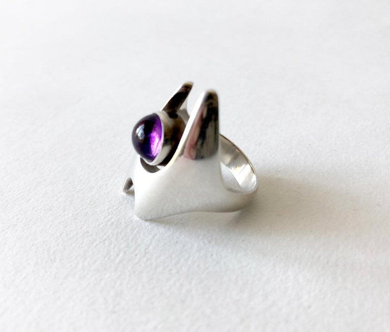 1960s Danish modernist sterling silver and amethyst cabochon ring created by Henning Koppel for Georg Jensen.  Ring is a finger size 7.5 and is signed Georg Jensen, 925, 139, Denmark.  In very good vintage condition.