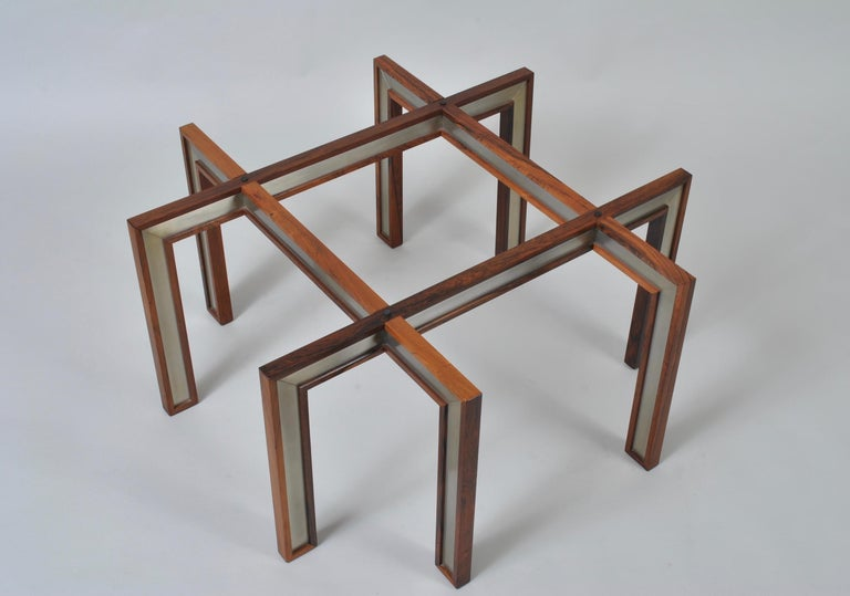 Distinctive glass, wood and brushed steel modernist design from Henning Korch. An excellent coffee or central table. Visually impressive. Thick glass surface. Produced by CFC Silkeborg, Denmark, circa 1960.