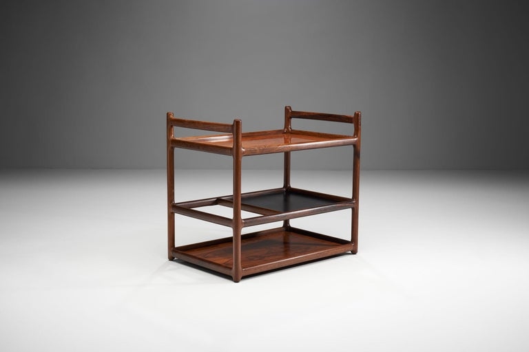 This serving cart is the work of Danish designer Henning Korch, who mainly designed tables and cabinets, prioritising the natural beauty of wood.   Korch, unlike most Danish designers, did not create seating, instead he perfected his craft