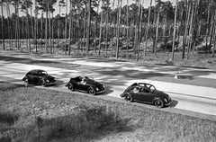 Three models of the Volkswagen beetle driving, Germany 1938 Printed Later