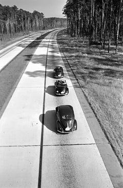 Three Volkswagen beetle on street, Germany 1938 Printed Later