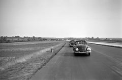 Two Volkswagen beetle on the highway, Germany 1938 Printed Later