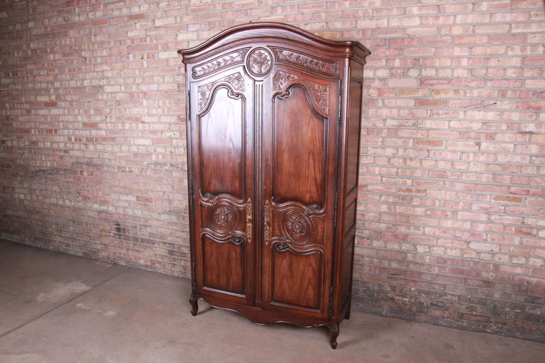 A gorgeous French Provincial Louis XV style armoire dresser