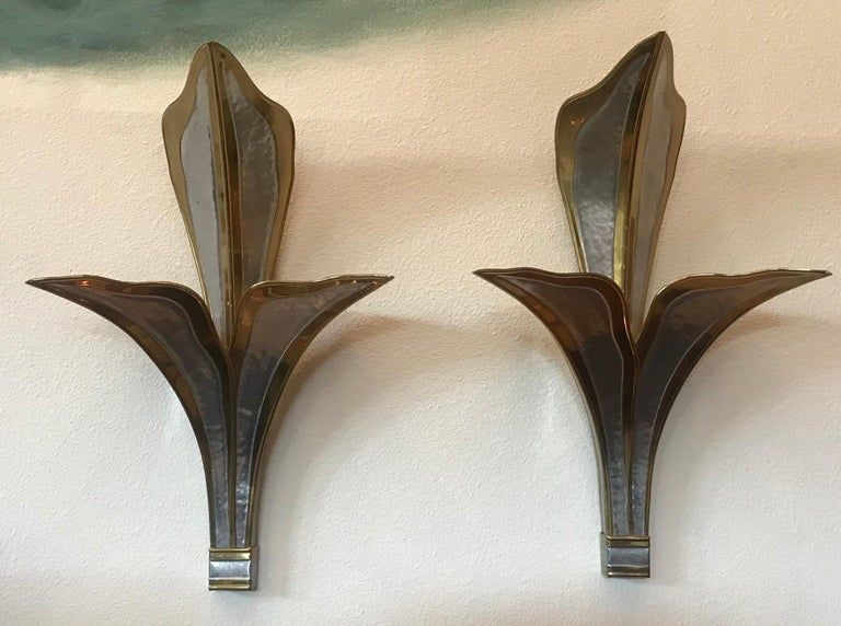 A wonderful pair of large handcrafted hammered brass and chrome wall lights by French designer Hendri Fernandez, 1980.