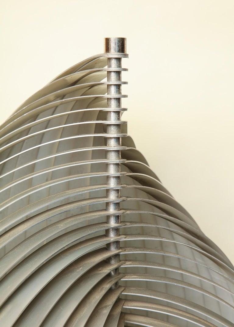 Henri Mathieu sculptural table lamp Mid-Century Modern composed aluminum bands, France, 1970s.
