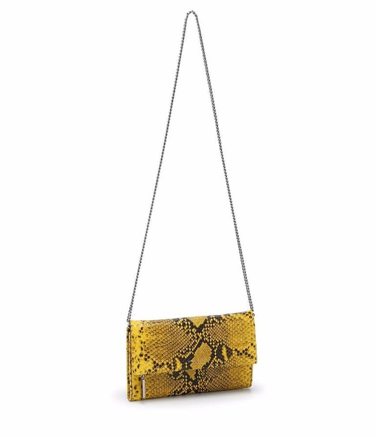 Henry Bendel Girls Night Out Embossed Snake Clutch Bag    - Black and Yellow Clutch Bag  - Embossed snake print effect  - Leather  - Flap front with magnetic closure  - Flap has zip compartment  - 2 internal compartments, 1 zip compartment, 8 card