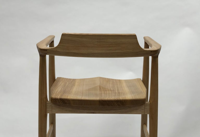 Henry the armchair is an original design by Brian Holcombe. Ergonomically designed around the human proportion this chair accommodates comfortable seating.  These chairs are individually handmade and can be purchased in a variety of materials by