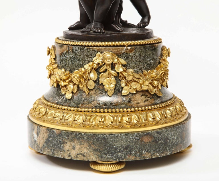 Henry Dasson, a French Gilt and Patinated Bronze Marble and Enamel Annular Clock For Sale 5