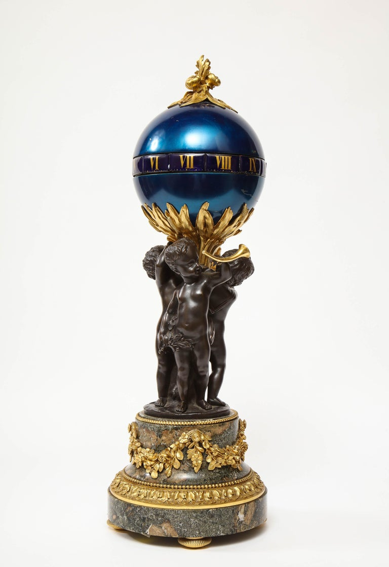 Napoleon III Henry Dasson, a French Gilt and Patinated Bronze Marble and Enamel Annular Clock For Sale