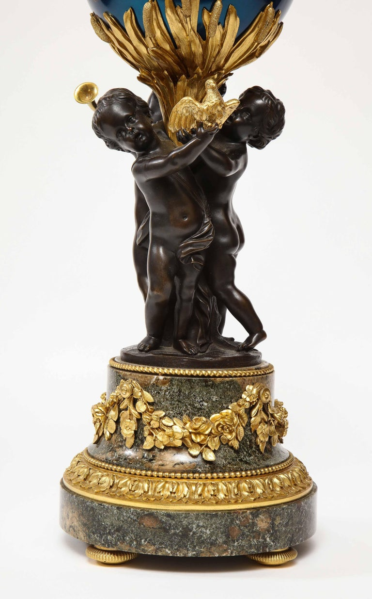 Henry Dasson, a French Gilt and Patinated Bronze Marble and Enamel Annular Clock In Good Condition For Sale In New York, NY