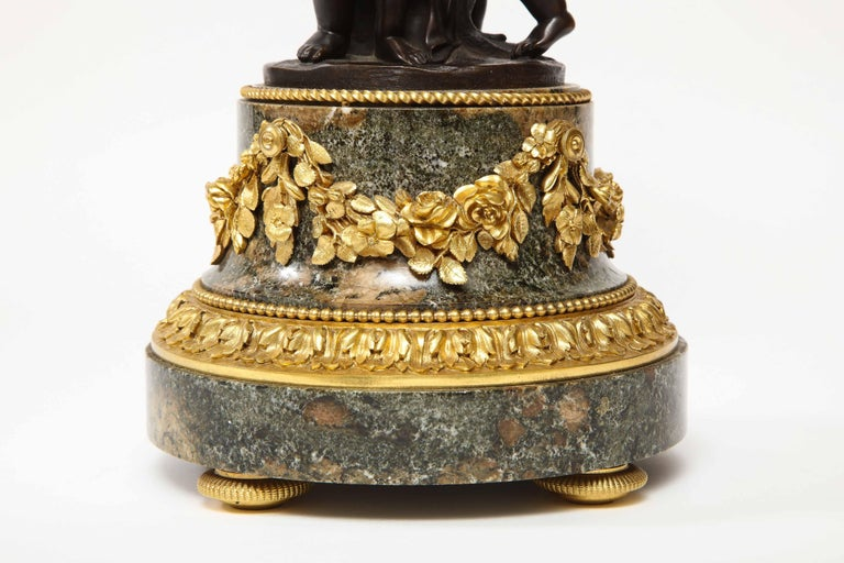 19th Century Henry Dasson, a French Gilt and Patinated Bronze Marble and Enamel Annular Clock For Sale