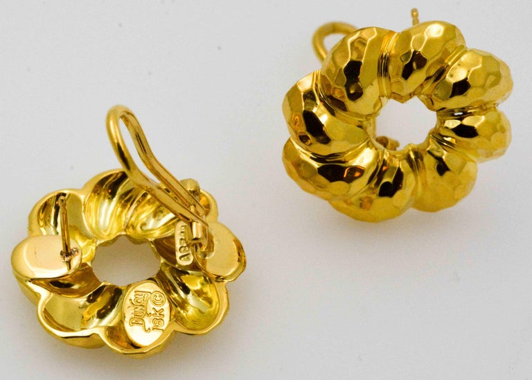 Fall in love with bright 18 karat yellow gold earrings all over again. The clever rippled facets create a flowery illusion in classic Henry Dunay earring jackets. Dunay crafted these earrings in 18 Karat yellow gold and with an Omega back. These