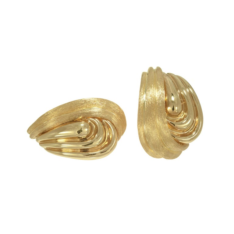Henry Dunay clip and post 18k yellow gold textured swirl design earrings  18k yellow gold  Stamped: 750 Hallmark: Dunay 24.2 grams Top to bottom: 29.8mm or 1 1/8 Inch Width: 18.96mm or ¾ Inch Depth or thickness: 7.2mm