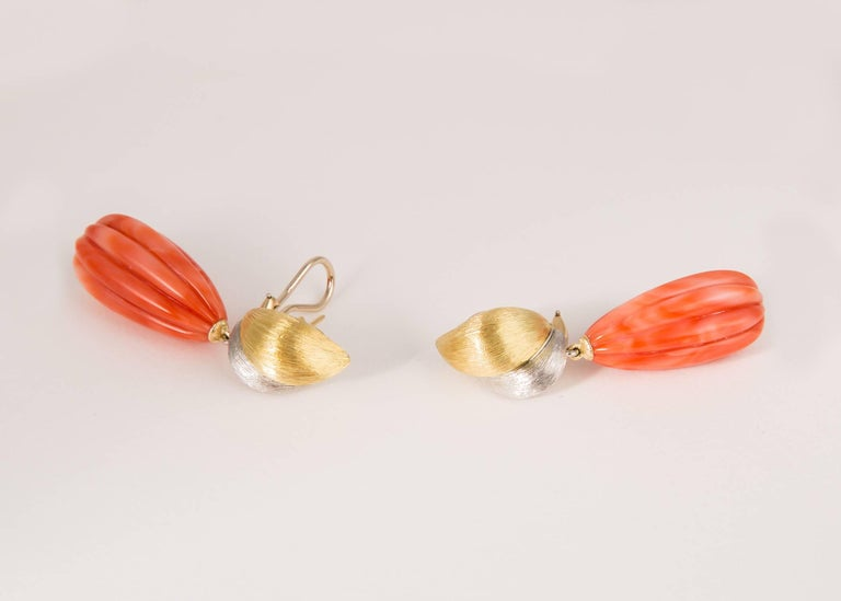 Simply spectacular. Henry Dunay combines rich 18k gold and platinum and elegant carved coral.  2 1/8 inches in length.