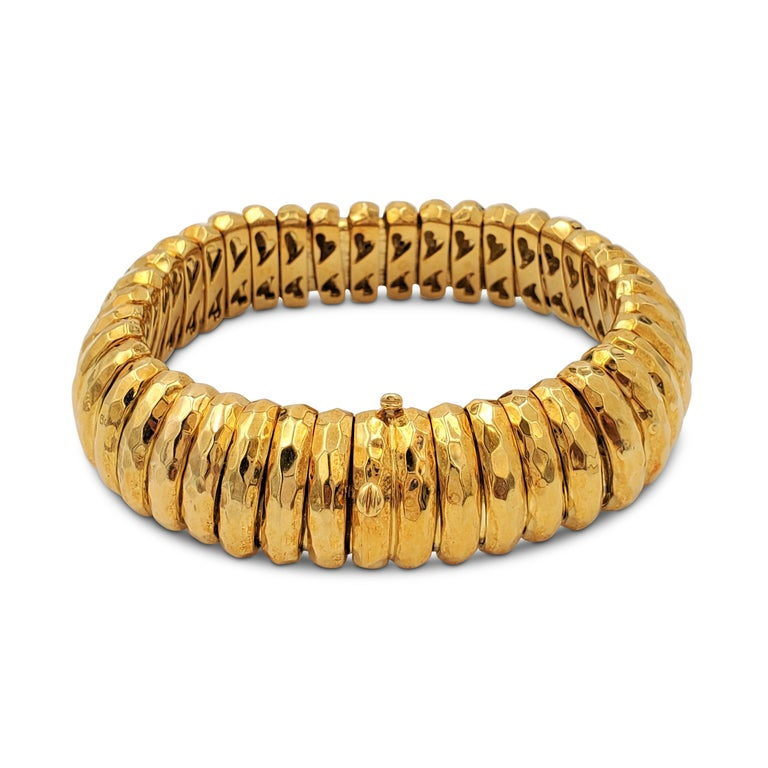 Authentic Henry Dunay bracelet crafted in 18 karat hammered gold.  Bracelet measures 8 3/4 inches in length and 3/4 inch in width with a box clasp. The flexible gold links are in excellent vintage condition and maintain their original patina. Signed