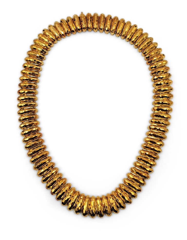 Authentic Henry Duany necklace crafted in 18 karat hammered gold.  Necklace measures 19 1/2 inches in length and 3/4 inch in width with a slide clasp.  The flexible links are in excellent vintage condition and maintain their original vintage patina.