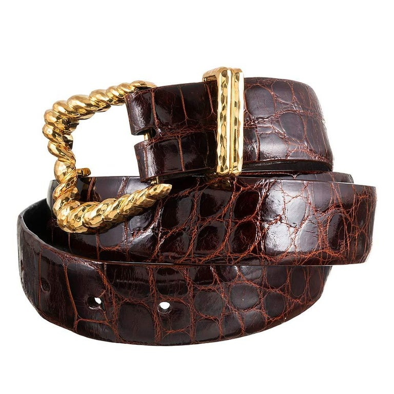 The hammered texture reflects light beautifully, augmenting the allure of the design. Henry Dunay is legendary for his goldsmith techniques and this belt easily recognizable as his own. The belt measures 51 inches from the buckle to the tip of the