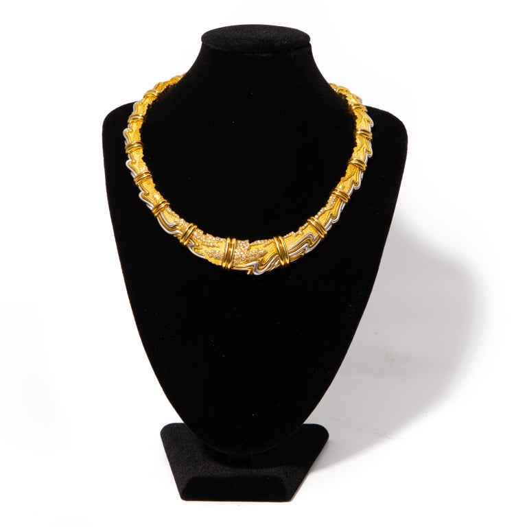 HENRY DUNAY, YELLOW GOLD, PLATINUM AND DIAMOND COLLAR NECKLACE. Consisting of textured matte and high polish graduating links, with organic yellow gold and platinum detail containing numerous round brilliant cut diamonds weighing approximately 1.65