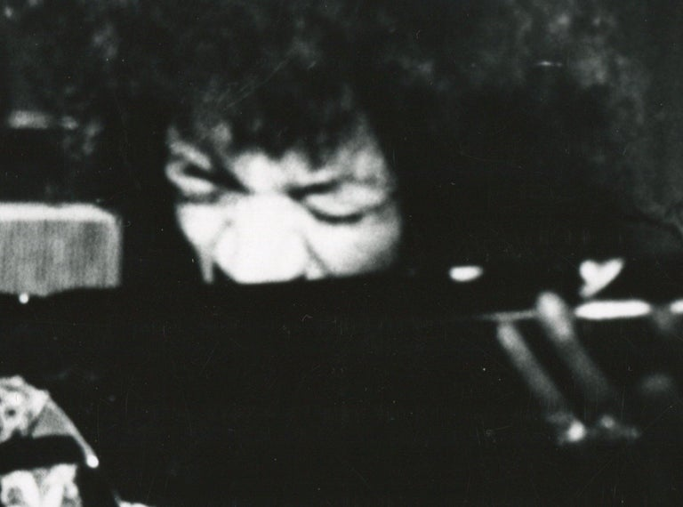 Jimi Hendrix live in concert - Photograph by Henry Grossman