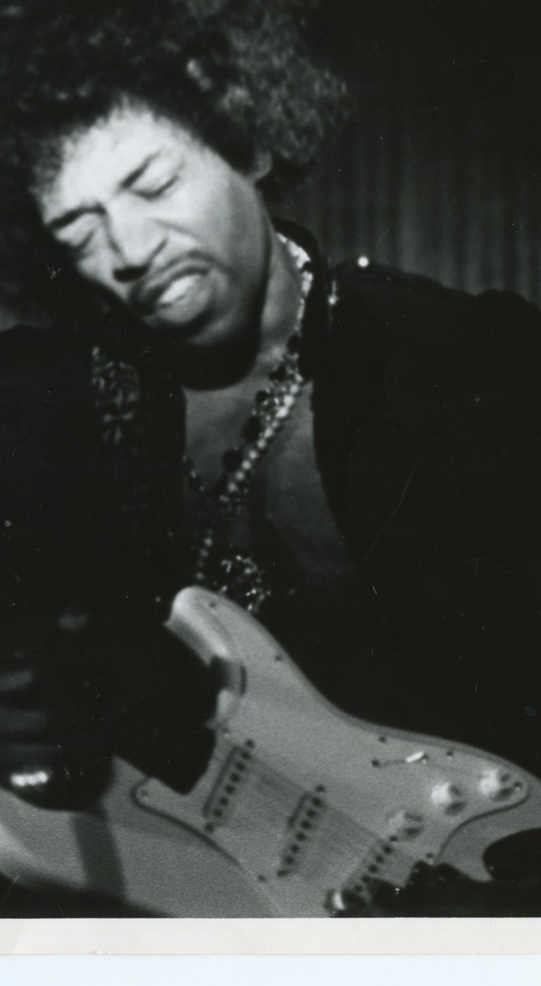 Henry Grossman Black and White Photograph - Jimi Hendrix live in concert