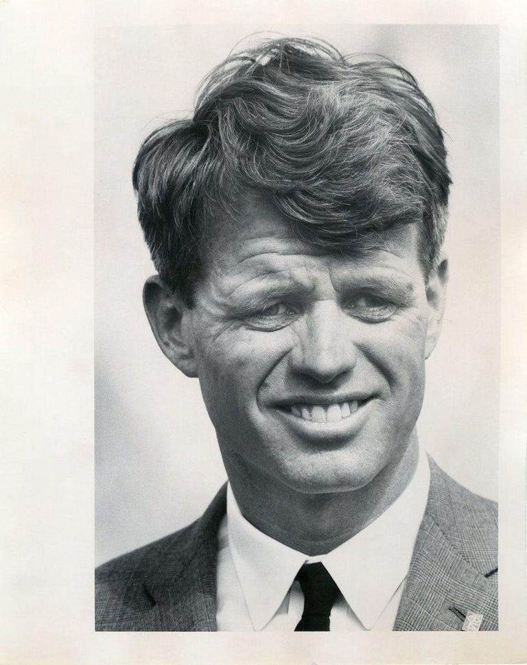 Portrait of Robert Kennedy is a b/w photograph taken by Henry Grossman very likely in 1968.  Print on polished paper with stamp of the photographer and stereotype on the back. In perfect conditions.  In this photo, Robert Francis Kennedy (also named