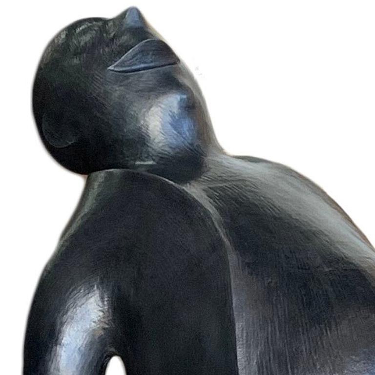 Bronze sculpture of a seated man laughing as he leans his head back. Edition of 7