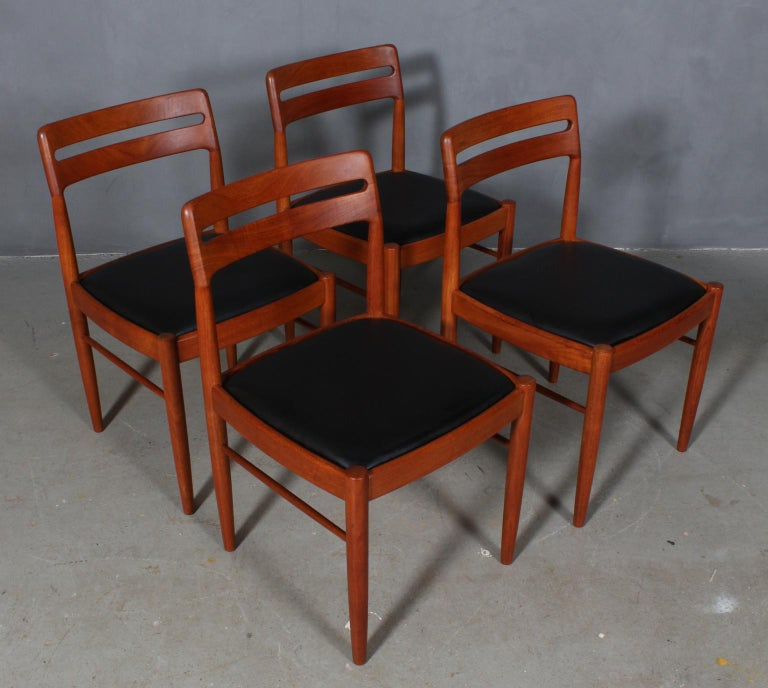 Henry Walter Klein four dining chairs in solid teak.  New upholstered with black aniline leather.  Made by Bramin, 1960s.