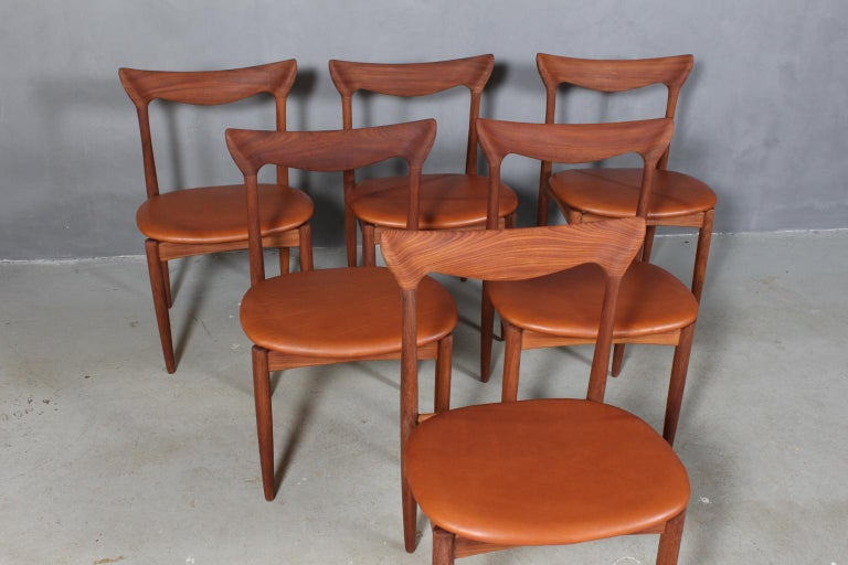 Henry Walter Klein six dining chairs in massive teak.  New upholstered with cognac aniline leather.  Made by Bramin.