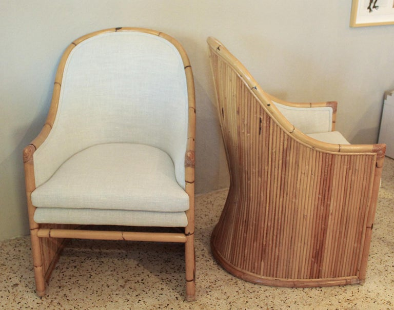 Stripe's 1970s sleek pair of bamboo chairs by Henry Olko are newly upholstered in luxurious slubby cream Belgian linen. Chairs retain their original Henry Olko metal labels. Priced and sold in sets of two. There are two sets available (for a total