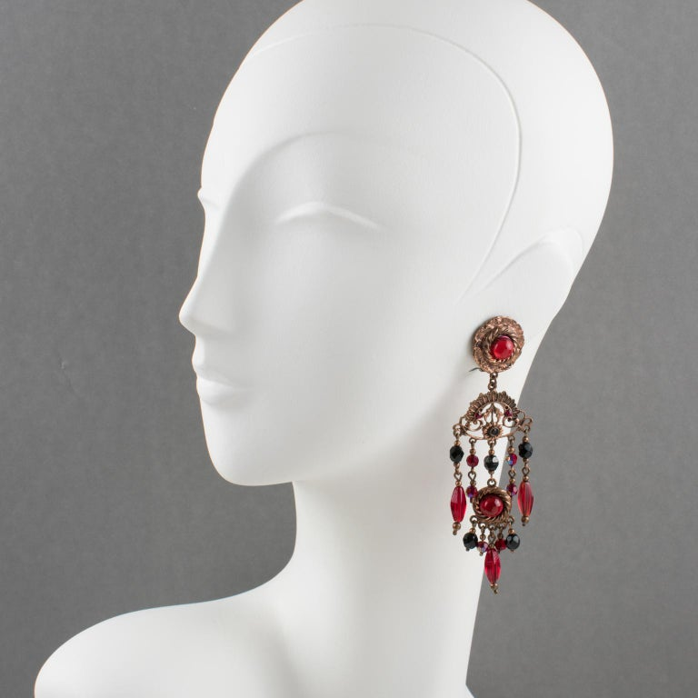 Fabulous French Jewelry designer Henry Perichon (aka Henry) signed clip-on earrings. Copper finish metal extra long dangling shape in a Victorian design inspiration ornate with red and black faceted crystal beads, and ruby red poured glass cabochon.